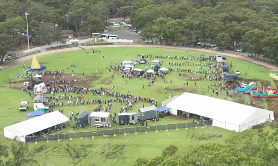 Aerial photograph of people queueing to enter tiny homes at the Tiny Homes Carnival