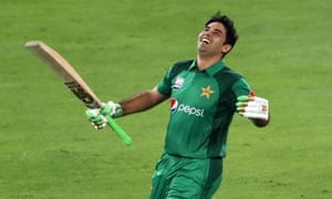 Pakistan's Abid Ali looks to the sky in celebration after completing his record-breaking century on debut.