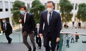 German health minister, Jens Spahn (right) arriving for a press conference