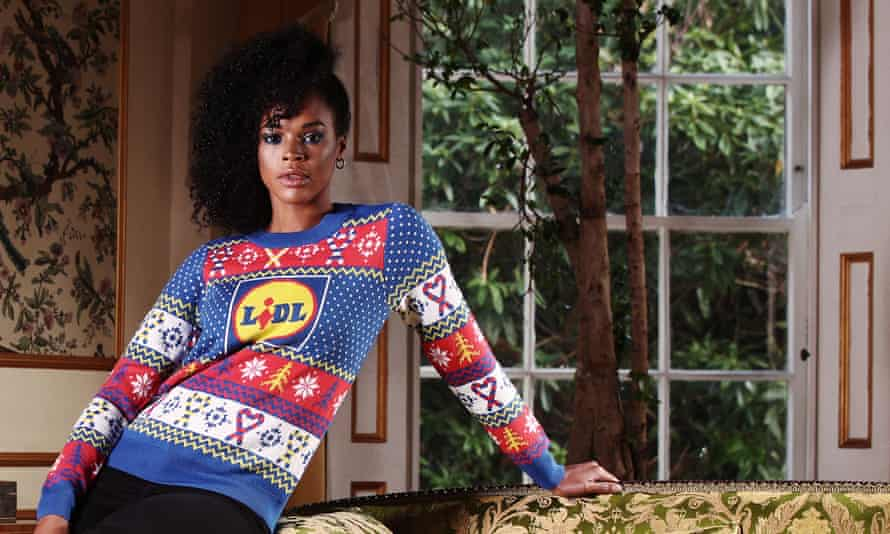 A woman wearing Lidl's Christmas jumper