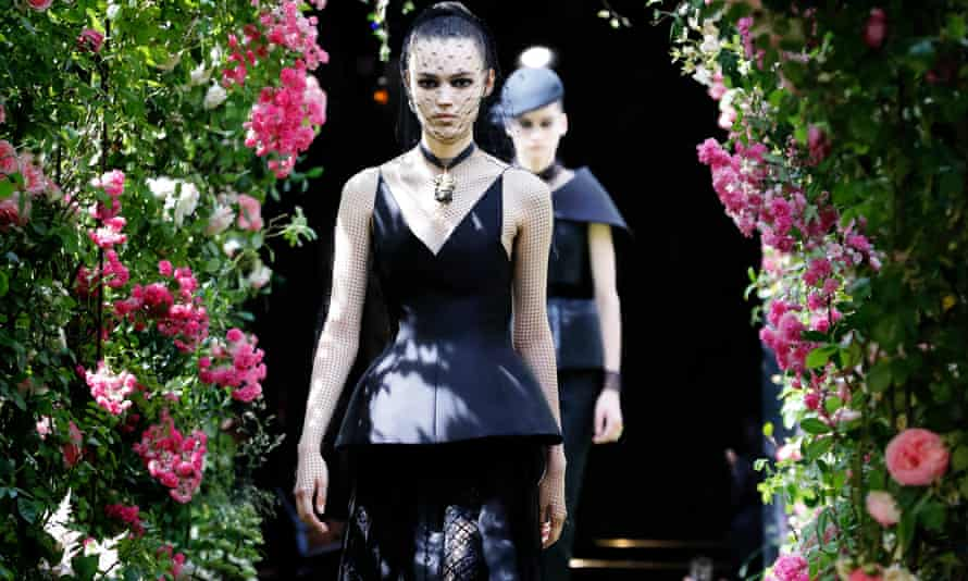 Models present creations by Christian Dior during the haute couture collection show in Paris.