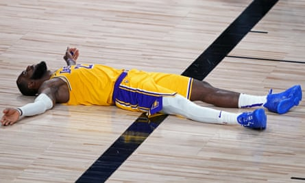 LeBron James lies on court as the Lakers make their way to a loss against Portland