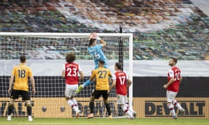 Arsenal's goalkeeper Emiliano Martinez cuts out a corner kick.