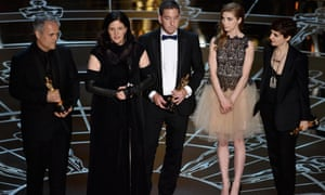 Director Laura Poitras, Dirk Wilutzky, journalist Glenn Greenwald and Edward Snowden's girlfriend Lindsay Mills accept the best documentary feature award for Citizenfour