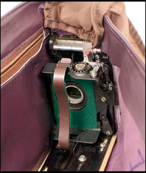 Handbag camera - with lens concealed behind buckle.
