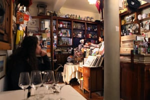 Shelves are packed with memorabilia inside the Drogheria della Rosa restaurant, which was once a pharmacy in, Bologna, Italy.