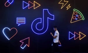 A man walks past a TikTok sign at an exhibition in Hangzhou, China