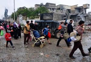 Civilians flee as the Iraqi counter-terrorism service advance towards the Yabasat neighbourhood