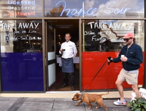 Geraud Fabre of French restaurant France-Soir waits for take-away orders