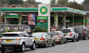 Vehicles queue outside a BP petrol station in Alton, Hampshire.