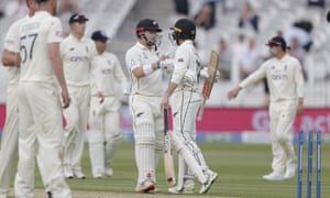 New Zealand batsmen Henry Nicholls and Devon Conway embrace as day one closes.