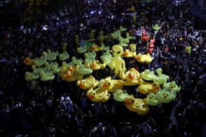 Protesters hold inflatable toys during a pro-democracy rally in Bangkok demanding the prime minister to resign and for reforms on the monarchy.