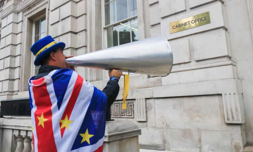 An anti-Brexit protester with tannoy outside the Cabinet Office in Whitehall.