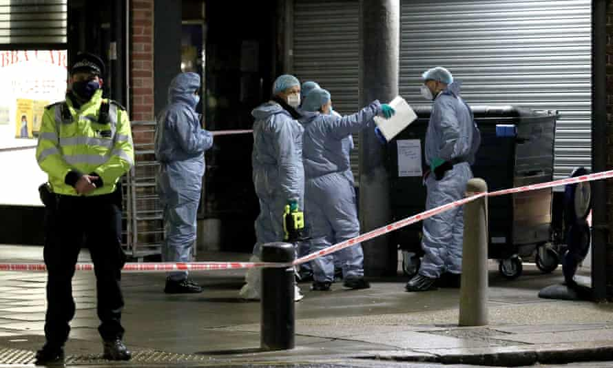 Forensics officers working at the scene of the stabbing in Newham.