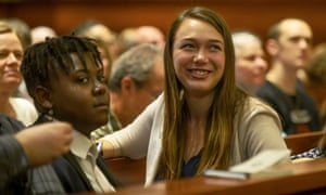 Plaintiff Vic Barrett, left, and Kelsey Juliana gathering with other youth plaintiffs in the Juliana v. United States climate change lawsuit in a federal courthouse for a hearing in front of a panel of judges in June.
