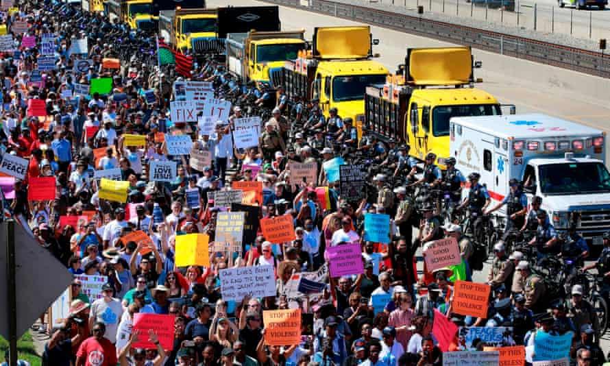 Protestors shut down the Dan Ryan Expressway during an anti-gun violence protest on Saturday