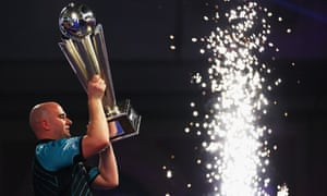 Rob Cross celebrates winning the PDC World Darts Championship final against Phil Taylor.