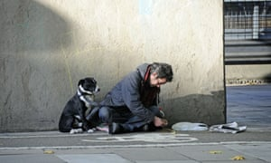 Homeless man with his dog in half shadow Euston Road London England UK. Image shot 10/2008. Exact date unknown.