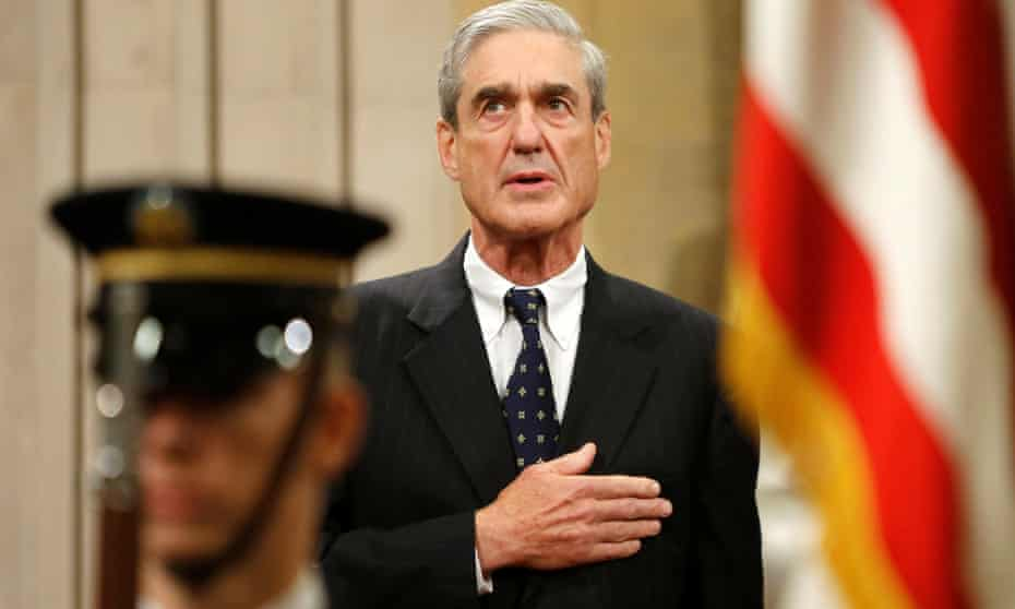 Robert Mueller stands for the national anthem during a ceremony at the justice department in Washington in 2013.