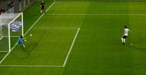 Germany's Ilkay Gundogan scores their equaliser from the penalty spot.
