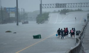 Residents are evacuated during the aftermath of Hurricane Harvey in Houston, Texas.