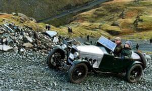 Vintage car climbing a steep rocky road
