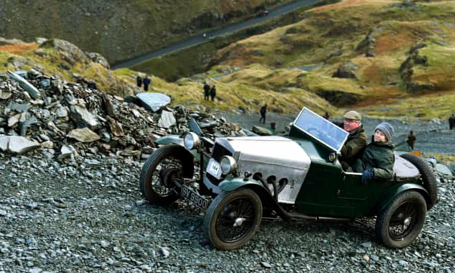 Vintage car climbing a steep rocky road