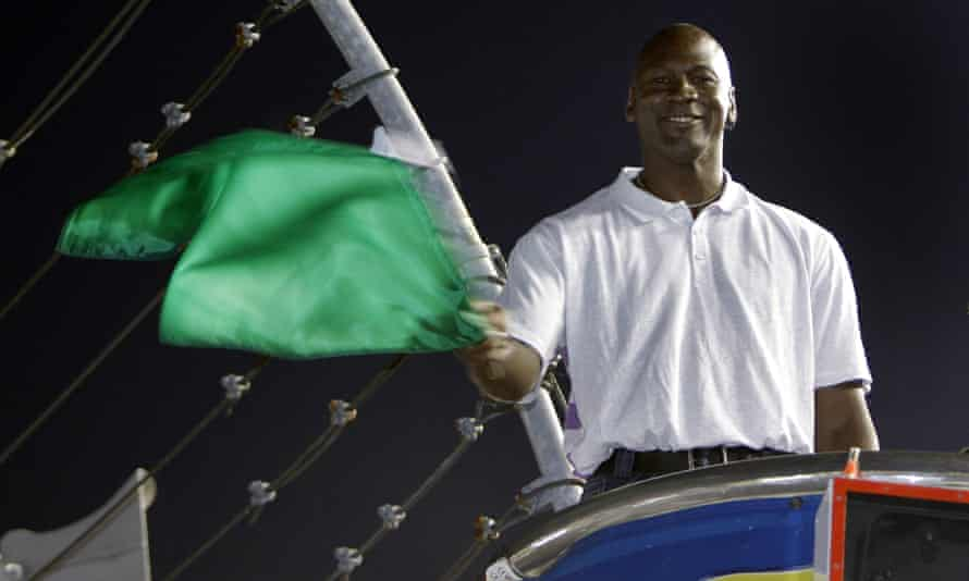 Michael Jordan waves the green flag before a Nascar race at Charlotte Motor Speedway in 2010