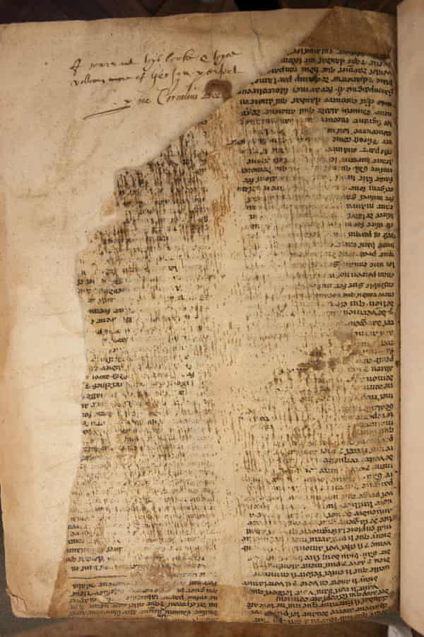 A close-up of one of the fragments showing damage to the text and an inscription in the host volume.