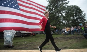 Senator Elizabeth Warren (D-MA) runs to the stage before speaking at the Polk County Democrats' Steak Fry on 21 September in Des Moines, Iowa.