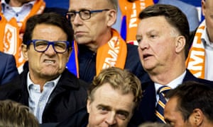 Fabio Capello and Louis van Gaal watch on in Amsterdam.