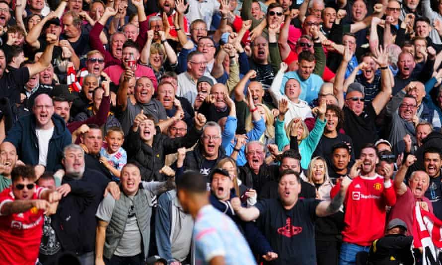 United fans celebrate with Mason Greenwood at Molineux.
