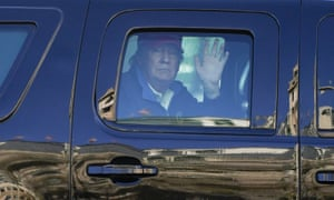 Donald Trump waves to supporters from his motorcade.