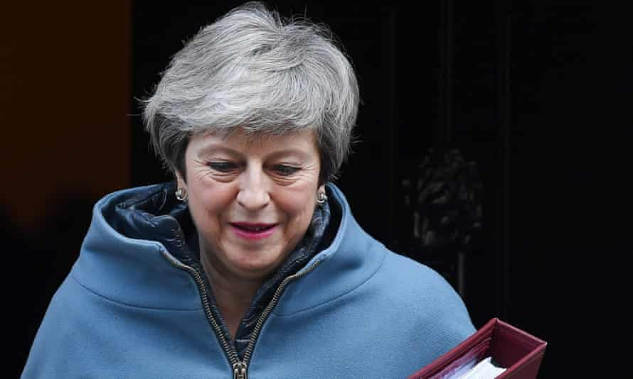 Theresa May told the National Conservative Convention the focus on delivering Brexit must be 'absolute'.