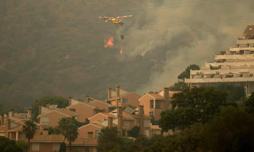 Helicopter above wildfire