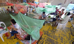 Patients suffering from dengue fever in a makeshift hospital in Maasin in the Philippine province of Iloilo.