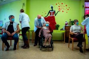 Josepha Delmotte, 102, receives a dose of the Pfizer/BioNTech Covid-19 vaccine at La Bonne Maison de Bouzanton care home during a vaccination operation in Mons, Belgium.