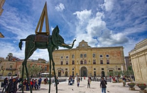 Tall stories: a huge Dali sculpture in the main square.