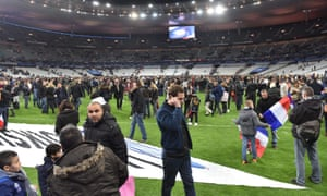 Spectators spill on to the pitch of the Stade de France after the international friendly against Germany