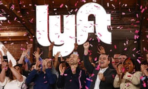 Lyft's CEO, Logan Green, and president, John Zimmer, celebrate the company's IPO in Los Angeles, California, on 29 March.