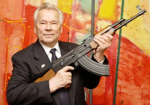 Russian weapon designer Mikhail Kalashnikov with the assault rifle that became ubiquitous in armies and militias worldwide.