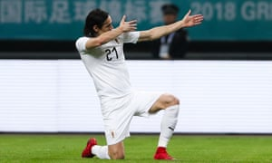 Edinson Cavani celebrates scoring against Wales.