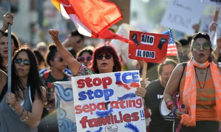 People rally at the 'Families Belong Together March' in Los Angeles, California on 14 June.