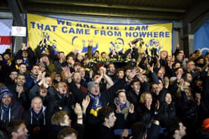 AFC Wimbledon fans celebrate in the stands during the FA Cup fourth-round match at Kingsmeadow