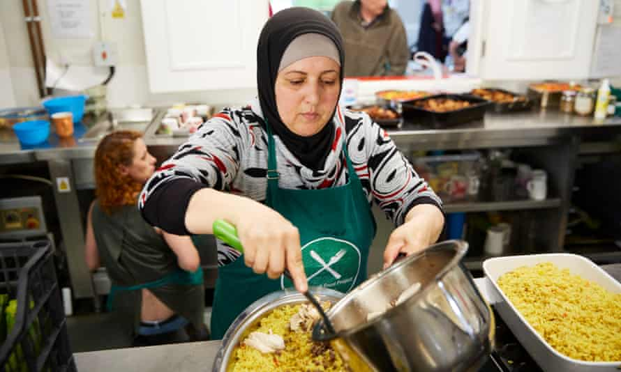 A woman prepares lunch at the Real Junk Food Project cafe at All Hallows in Leeds.