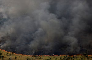 A burning forest seen during Operation Green Wave, conducted by agents of the Brazilian Institute for the Environment and Renewable Natural Resources, to combat illegal logging in Apui, in the state of Amazonas, Brazil