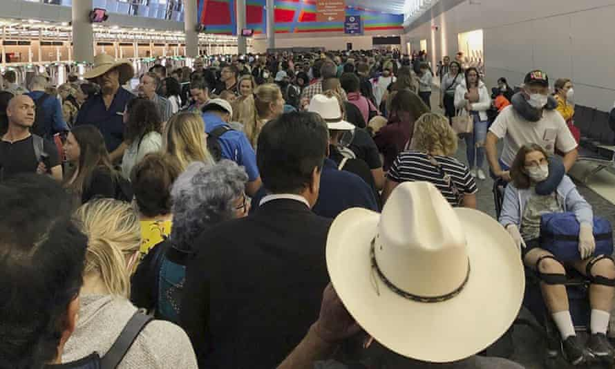 People wait in line to go through the customs at Dallas Fort Worth International Airport in Grapevine, Texas.