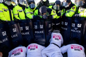 Police block protesters near the national assembly building in Seoul, South Korea