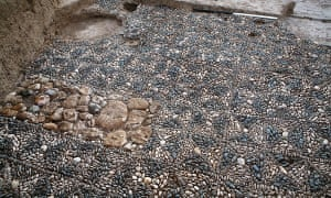 Pebble mosaic pavement in one of the courtyards of the administrative building. These chequerboard pavements are characteristic of Neo-Assyrian buildings. Black and white pebbles are used to lay out a grid of squares, with each square quartered diagonally.