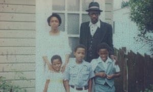 Sarah M Broom's father, Simon, with her siblings outside their house at 4121 Wilson Avenue in 1977.